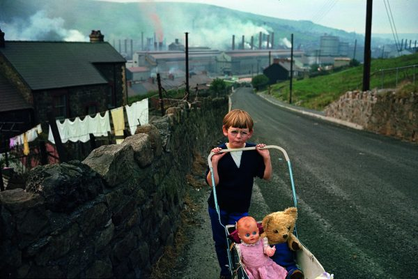 Color photo by Bruce Davidson, South Wales, mining community, portrait of boy with pram