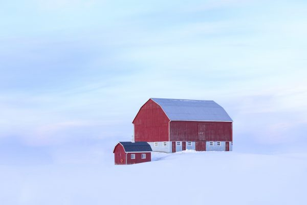 color landscape photograph of a red barn and snow in Canada