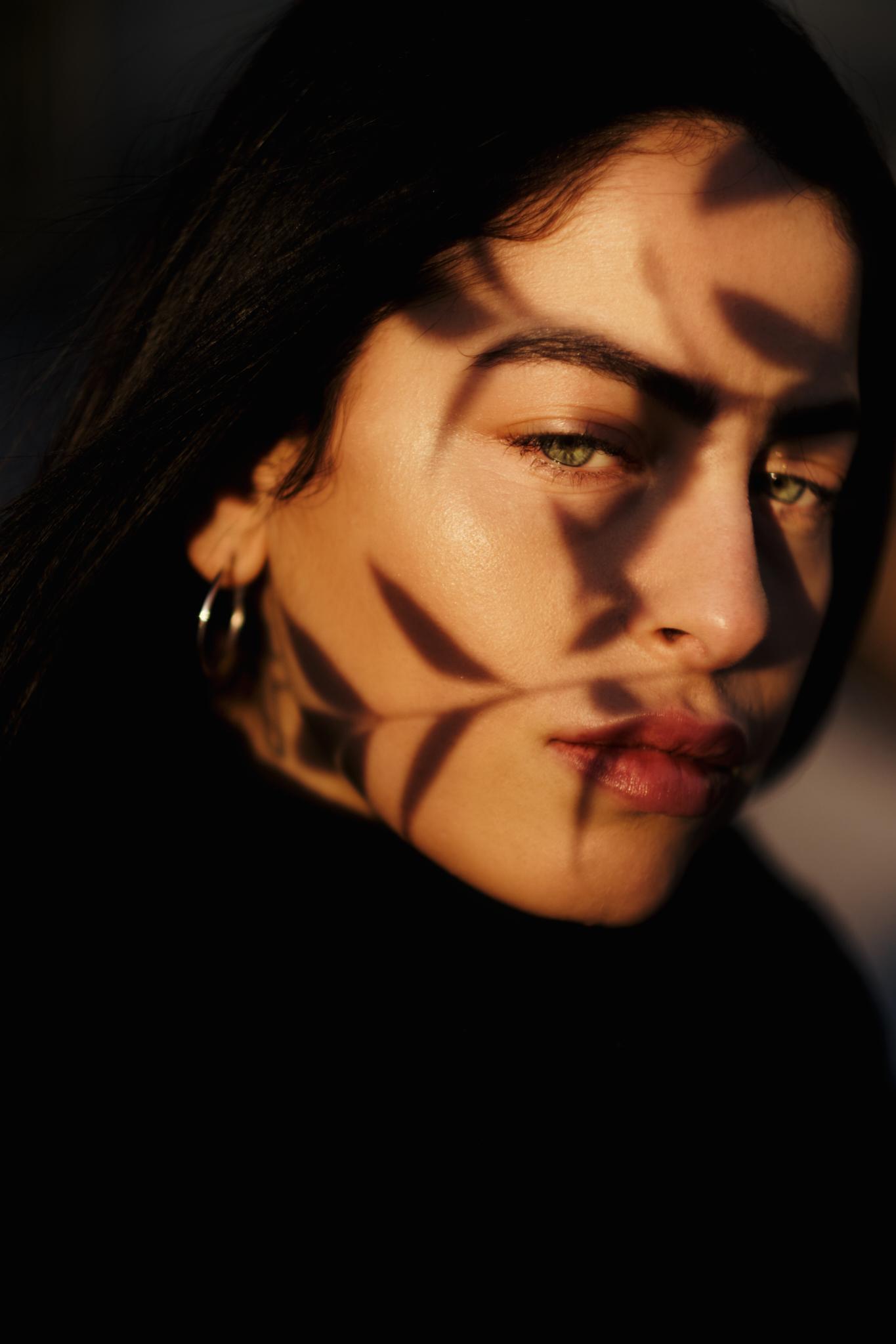 Outdoor color portrait photograph of a woman by Fabio Salmoirago