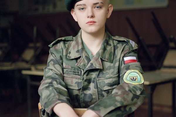 Color portrait of a young Polish boy at military high school in Poland by Natalia Kepesz