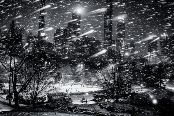 black and white landscape photograph of New York City, USA during snowstorm at night