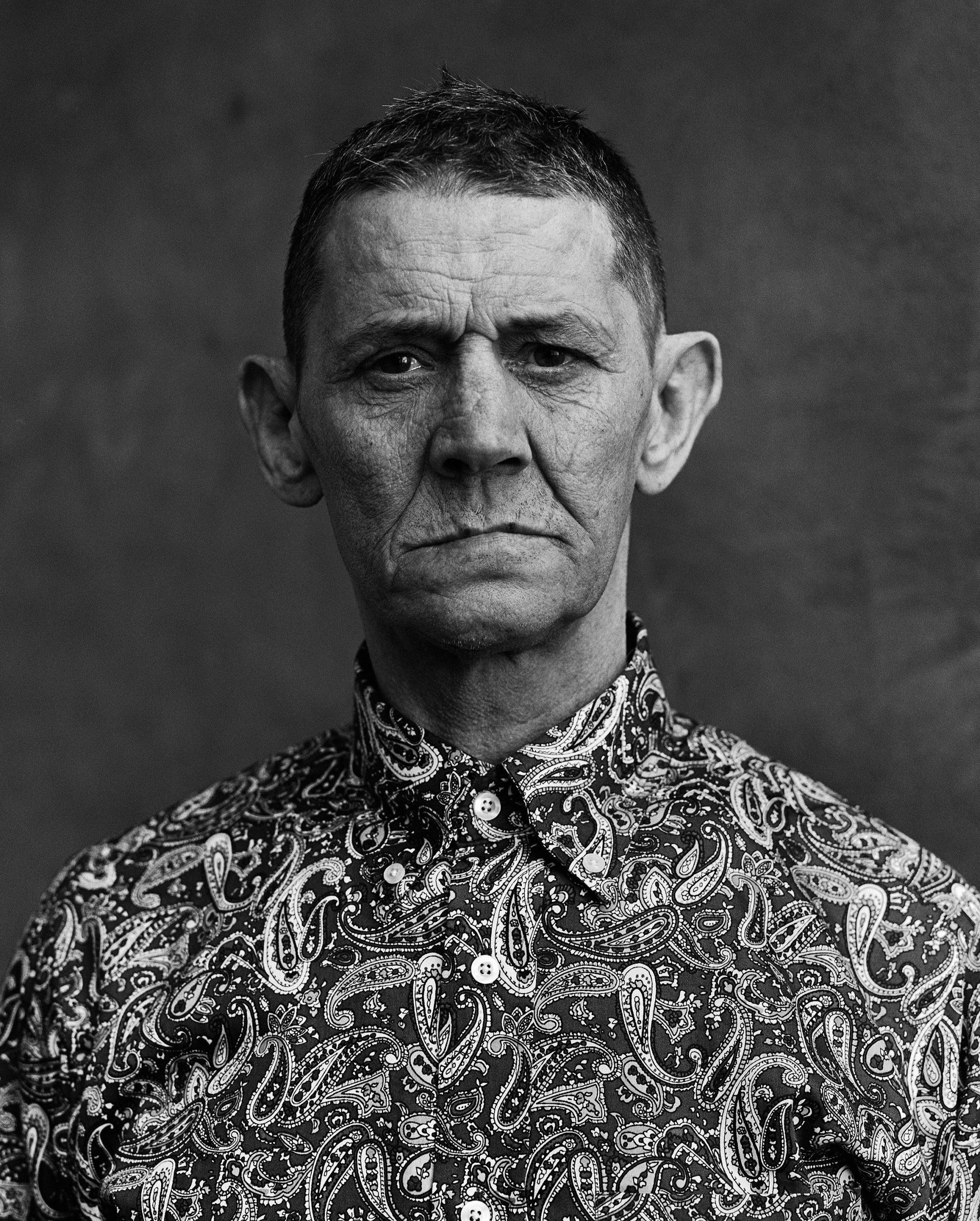 Medium format analog black&white portrait photograph of a man in Glasgow, Scotland by Simon Murphy