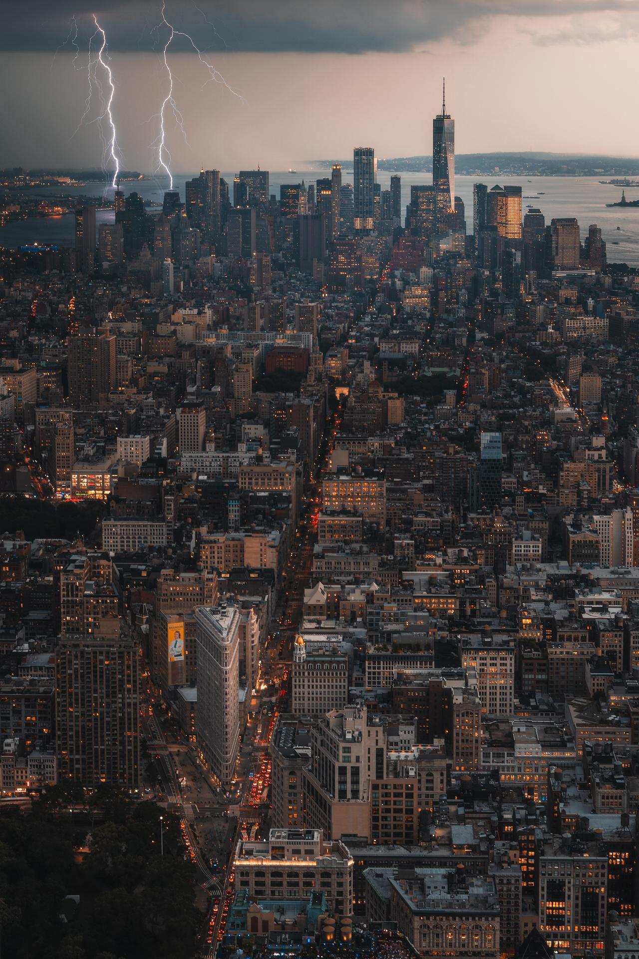 color landscape photograph of Lighting bolts over Manhattan, New York City , USA
